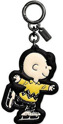 Coach x Peanuts Charlie Brown Ice-Skating Charm in Snoopy Box. 20926 B